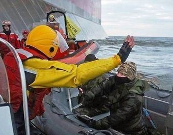 A Russian Coast guard officer is seen pointing a knife at a Greenpeace International activist as five activists attempt to climb the 'Prirazlomnaya,' an oil platform operated by Russian state-owned energy giant Gazprom platform in Russia s Pechora Sea.  This is one example of the disproportionate use of force by the Russian authorities during a peaceful protest. The activists are there to stop it from becoming the first to produce oil from the ice-filled waters of the Arctic.